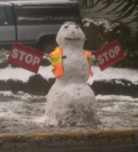 crossing guard made of snow